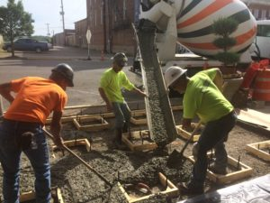 A crew from Stockmeister Enterprises are pictured pouring concrete where the bronze stars will be installed in front of the Markay Cultural Arts Center Tuesday. The unveiling of the bronze stars will be Sunday, May 28 at 2 p.m. The public is invited to attend.